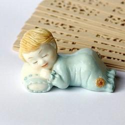 Statuetta in resina di bambino addormentato colore blu