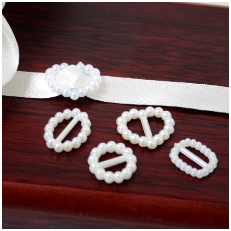 12 piccoli ornamenti ovali di perle di avorio di plastica per nastri