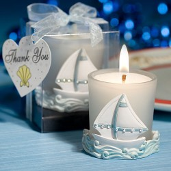 Portacandele con barca a vela bianca e azzurra