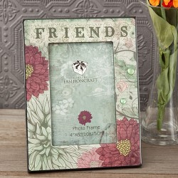 Cornice portafoto con fantasia floreale sul verde