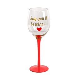 Calice di vino rosso con frase