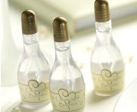 Bolle di sapone a forma di bottiglia di champagne oro